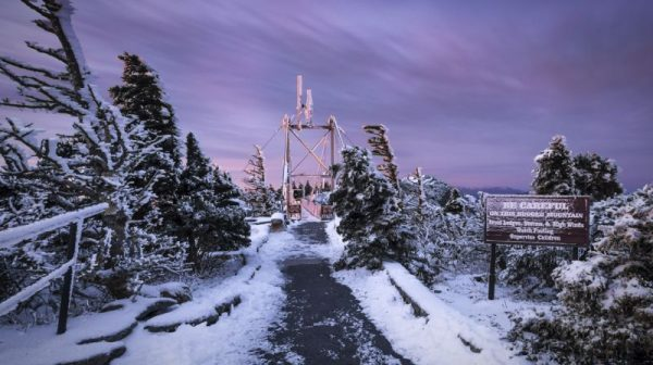 A blanket of snow covers the Mile-High Swinging Bridge at Grandfather Mountain