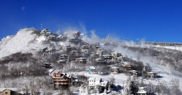 A blanket of snow covers the town of Beech Mountain