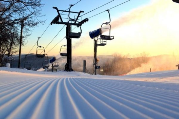 The sun rises over the lifts at Appalachian Ski Mountain