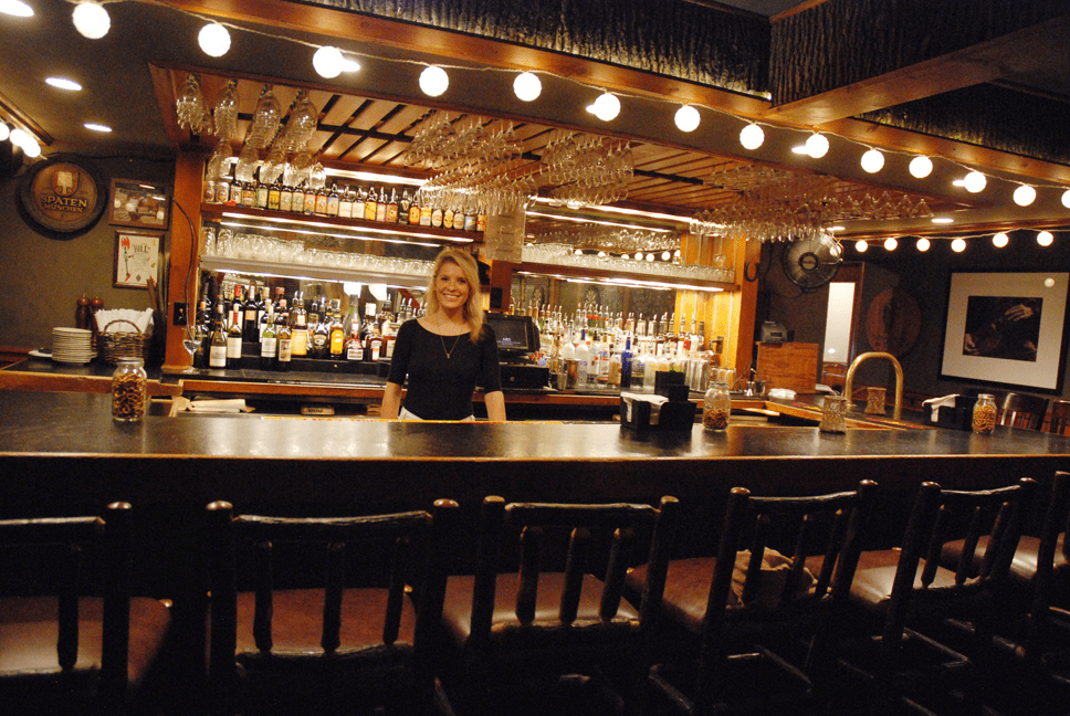 A waitress behind the bar at Twigs Restaurant in Blowing Rock