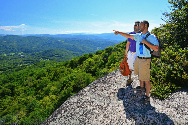 Two men pointing at a spot on the Emerald Outlook Hiking Trail
